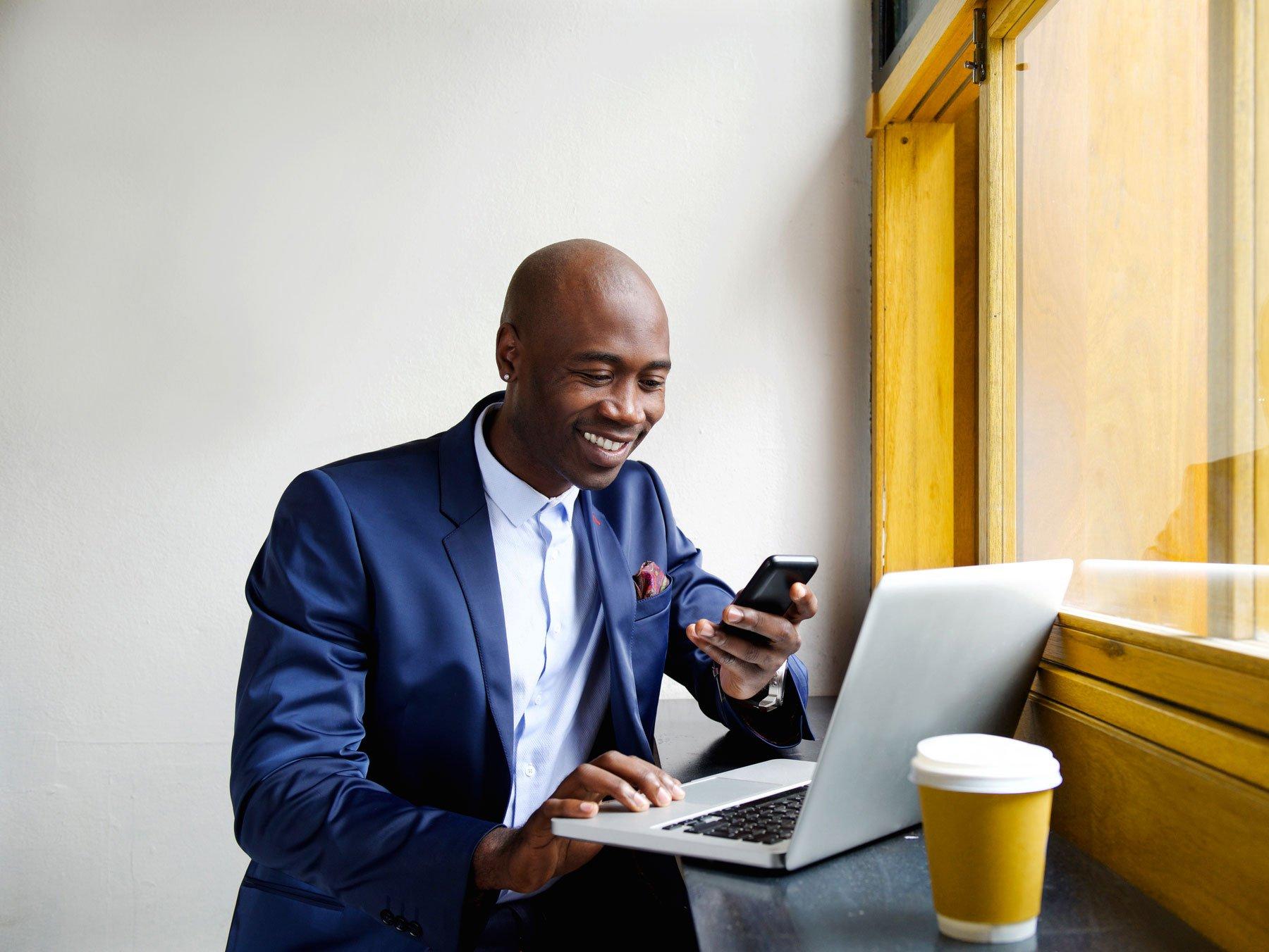 african_american_man_mobile_phone_laptop