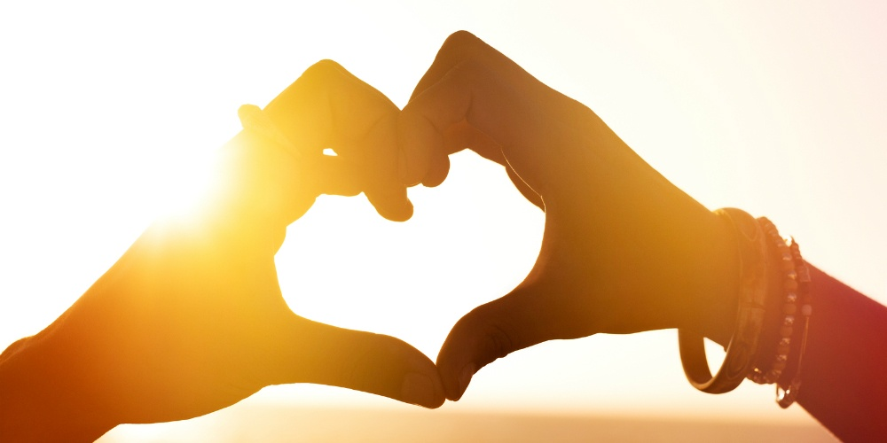 bigstock-Heart-shape-of-hands-against-s-138915770