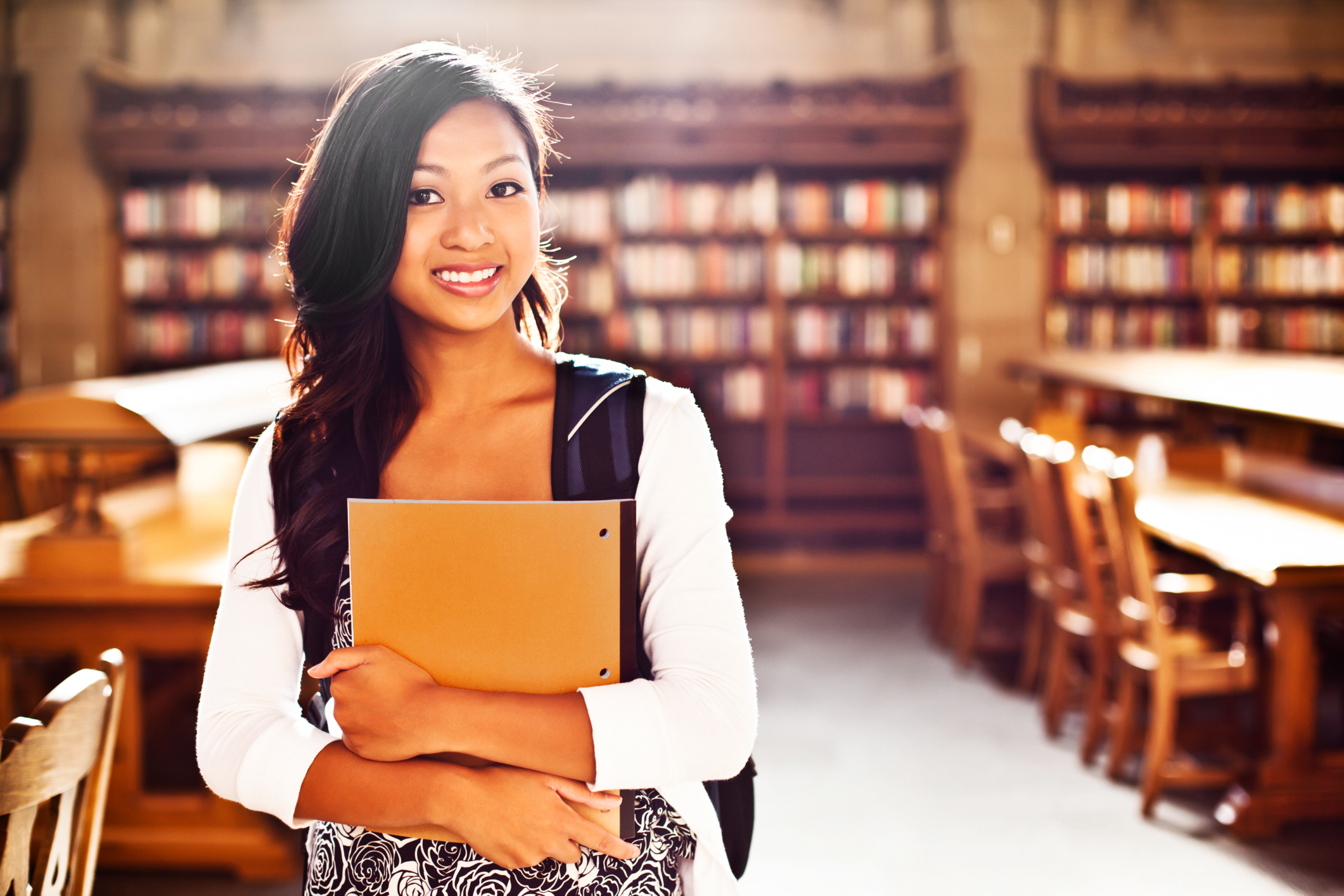 college_student_with_orange_notebook